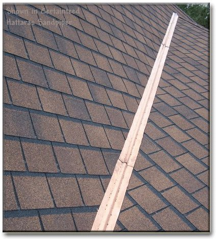 asphalt shingle roof with metal valley