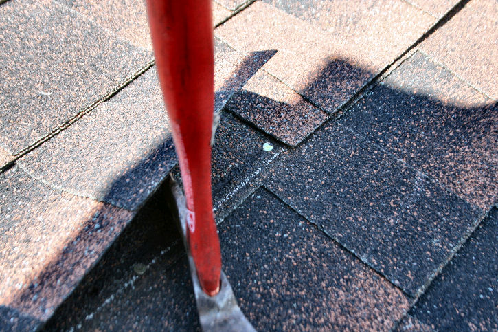 nail in butt joint of asphalt roofing shingle